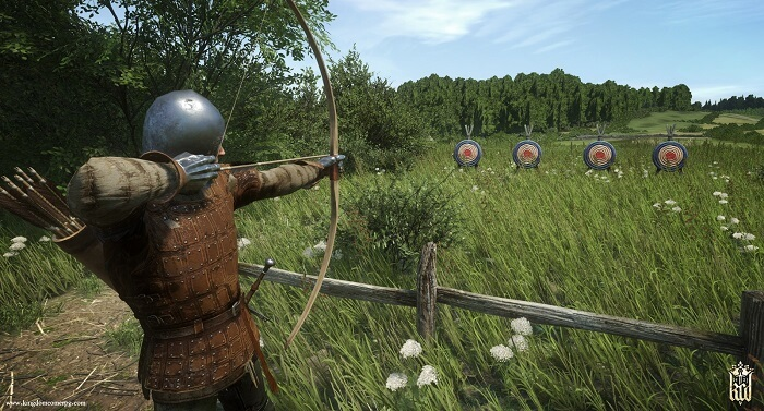 kingdom come deliverance game screenshot with archery training moment where a character aims for a target with bow and arrow
