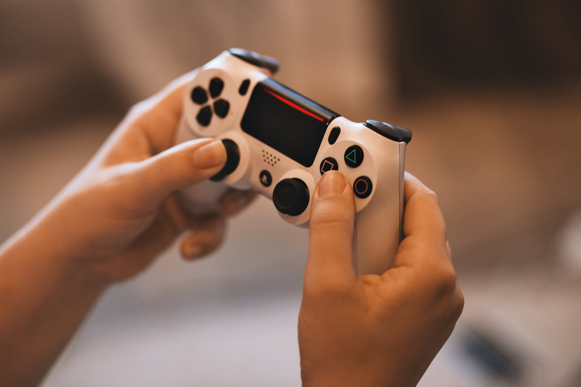 Person holding a controller