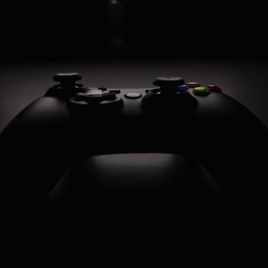 shallow focus photography of black Xbox controller